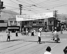 A Photograph of Banners hanging Across the Streets of Seoul, Korea Promoting Peace During the Korean War, circa June 1952.