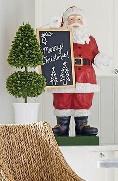 Clutching a blackboard for personalized holiday announcements, this charming figurine is a beacon of yuletide celebration. Lovingly handcrafted with handpainted details, it is sure to be the star of your holiday entertaining space.