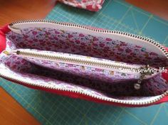 Sam's sewing life: bow compartment Clutch. How to make a zippered pouch with a zipper compartment inside. In Japanese, and Google's translation is ROUGH! But there are lots of great pix.