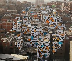 in an effort to challenge preconceived notions about cultures and communities, 'calligraffiti' artist eL Seed has realized 'perception' in the neighborhood of manshiyat nasr in cairo. the installation has been set in the coptic community of zaraeeb — a place known for collecting trash in the city, and for developing an efficient and profitable recycling system for it.