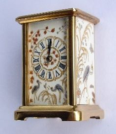 1:12 scale working four panel French mantle clock: brass gold-plated case. The beautiful panels are engraved and infilled with metallic paint depicting Japanese scenes. The front is polished bevelled glass. Quality swiss movement.  Halls Miniature Clocks.