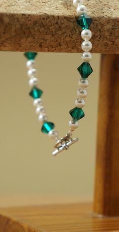 Handmade Swarovski crystal and pearl bracelet. $52.50 https://www.etsy.com/listing/196131648/swarovski-crystal-and-pearl-bracelet