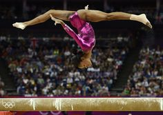 Gabrielle Douglas of the U.S. competes in the balance beam during the women's individual all-around gymnastics final in the North Greenwich Arena during the London 2012 Olympic Games August 2, 2012.  DYLAN MARTINEZ, England
