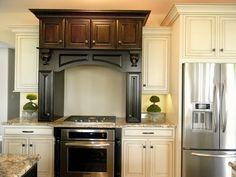 glazed white cabinets mixed with dark stained cabinets