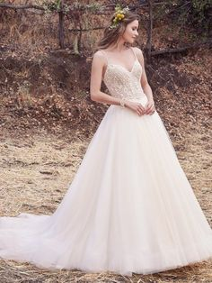 Maggie Sottero - janessa marie, This enchanting ballgown features an unlined bodice with exposed boning accented in beaded embroidery atop a voluminous tulle skirt. Beaded spaghetti straps glide from sweetheart neckline into a scoop back with sheer trim, creating a unique crisscross effect. Finished with crystal buttons over zipper closure. Lined bodice also available (Janessa, 7MS936).