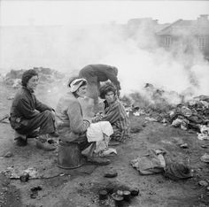 THE LIBERATION OF BERGEN-BELSEN CONCENTRATION CAMP, APRIL 1945. Women inmates burn the clothes of the dead to limit the spread of disease.