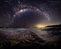 Photography by Troy Casswell.  A starbow / star trails panorama with the richest part of the Milky Way whipping up and around the south celestial pole over the shores of Coolum Beach. This is the first workout of the new 6D using available light only.
