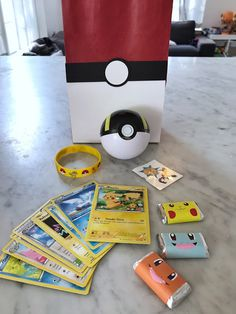 Poke Ball favor bags filled with Pokémon party favors for a Pokémon-themed birthday party. Click or visit FabEveryday.com to see details and DIY instructions for a Pokémon or Pokémon Go themed kid's party, including printables, food, decorations, favors, and party activities.