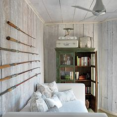 Contemporary New York Beach Cottage | Display Hidden Treasures | CoastalLiving.com Like fishing poles on wall.