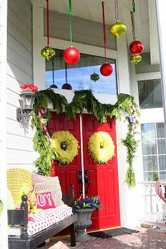 I LOVE the huge ornaments hanging from the porch!