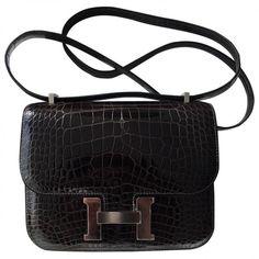 Constance alligator handbag HERMÈS (1.860.920 RUB) ❤ liked on Polyvore featuring bags, handbags, handbag purse, hermes purse, hermes bag, purse bag and alligator purse