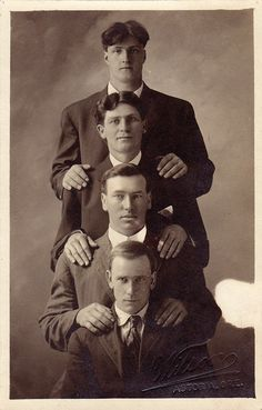 Much to my amazement, awkward family photos occurred LONG before I was born.    Four men, Astoria, Oregon, circa 1910 by boobob92, via Flickr