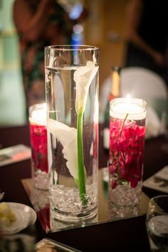 Submerged calla lilies and orchids with candles @Shelley Parker Herke Powers Studios
