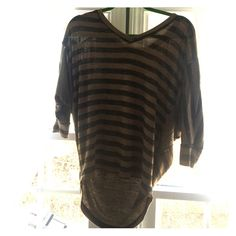 A shirt that it longer in the back It's an astonishing brown and black striped shirt that's is short in the front but longer in the back! It is soooo nice. You guys would love it. This would look great with some of the shoes I'm selling! Go check them out Forever 21 Tops