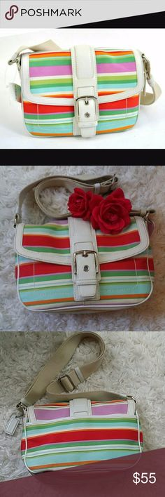"COACH Hampton Striped Cross Body Bag F10701 Leather Trim + Fabric. Multi color Red purple green white blue orange. Adjustable strap for shoulder or Cross body use. Front buckle feature flap with snap closure. Large back slip pocket with snap closure. Lime Green interior fabric with 1 zippered pocket and 2 slip multi function pockets. Measures 6"" height, 9"" length, 3 1/2 depth. Coach creed patch with style and serial number A0769-F10701. Gently used condition Coach Bags Crossbody Bags"