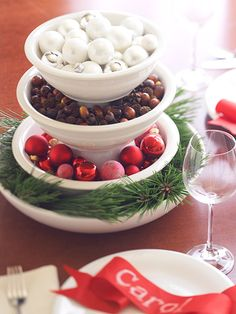 Stacked Bowl Centerpiece  Look around the house -- you likely have everything you need to whip up a pretty centerpiece in a jiffy. Stack white bowls filled with small ornaments, nuts, fir cuttings, or berries for an inspired design.
