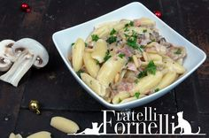 Rocchetti pasta served with a creamy sauce with fresh mushrooms and ham, perfect for Christmas dinner - Fratelli ai Fornelli