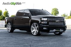 """2014 Chevy Silverado 1500 26"""" Giovanna Dramuno 6 Silver machine wheels wheel, and tire set up is 26x10 wrapped with 295-30-26 Tires lowered 3"""" in the Front and 5"""" in the Rear"""