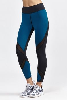 The Hydra Crop Legging by Michi is a three-fabric cropped legging with mesh panels mixed in with ...