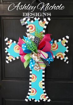 """This large beautiful cross represents everything that Easter means!!This wooden door decor cross or home decoration would be a greatitem to have in your collection for all year round too!!Made using 1/4"""" plywood, painted black on back for a polished look. Width 22"""", Height 31"""""""