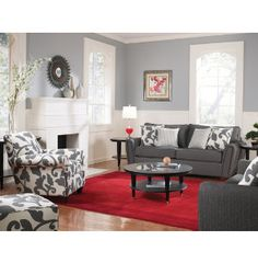 Love the neutral room, with the bright rug and patterned accent chairs and pillows.