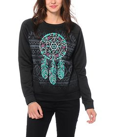 Set your style apart from the rest with an ultra comfortable look in this soft fleece crew neck sweatshirt that features a tribal design at the front with a dreamcatcher graphic.