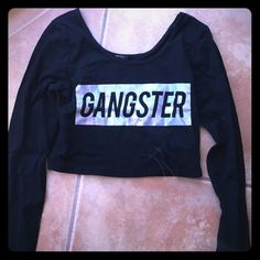 Forever 21 Gangster crop top Need I say more? Only discounting BC it's slightly cracked, but it looks good that way. I'm a small, this is a large and it worked well, just not tight fitting if you're a small. Forever 21 Tops Crop Tops