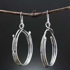 b27b3a8a0 Elegant sterling silver twig hoop earrings. Created by metal smith Sherry  Tinsman whose work is
