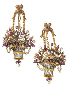 Enamel, ruby, emerald, sapphire and pearl ear pedants, mid-19th century, probably English, designed as flower filled baskets hanging from bows on gold chains. The baskets are united by swags of pearl set chains.