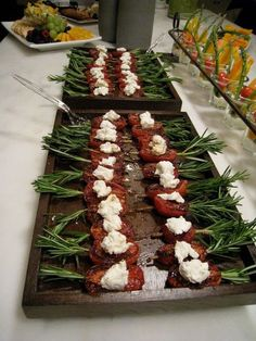 """Pistachio-encrusted pork tenderloin bites on rosemary """"skewers"""" with a mango aioli or herbed ricotta cheese"""