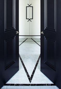 Beautiful black doors leading into chic entrance
