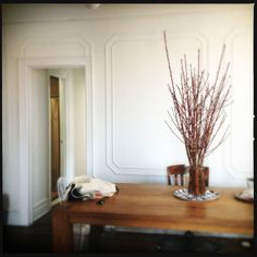 Using cut branches as a centerpiece and keeping them fresh (via Apartment Therapy)