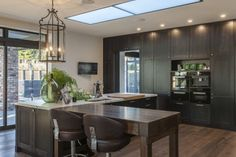 A mobile, bench-height table at one end of the island forms the gathering hub of the kitchen. Property Design, New Kitchen, Kitchen Ideas, Working Area, Skylight, Interior Design Kitchen, Kiwi, Contemporary Design, Design Inspiration