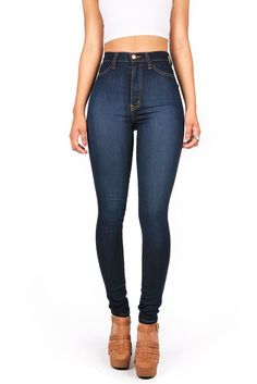 High waisted skinny jeans in a dark denim wash. Faux pockets at the front and open pockets at the back. Zip fly and button closure. *Machine Wash Cold *49% Siro Rayon/ 33% Cotton/ 17% Polyester/ 1% Sp