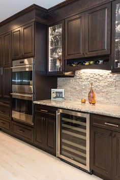 Built-ins with a Bar Area mediterranean-kitchen. http://www.kmrenovate.com