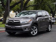 2014 Toyota Highlander - Backup camera, power lift gate, third row seating, captain's chairs on second row, heated seats