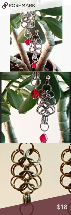 """Handmade Chainmaille Earrings. 4 in 1 Weave. Entirely handcrafted from 16 gauge stainless steel, each ring is hand wound, hand cut, and hand woven. These are done in the classic four in one weave, the same weave used in medieval Maille armour. 2"""" long, 3/4"""" wide. Made in U.S.A. Lady Adorned Boutique Jewelry Earrings"""