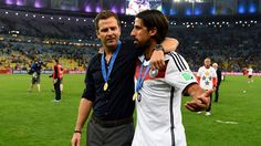 RIO DE JANEIRO, BRAZIL - JULY 13: Sami Khedira (R) of Germany celebrates the win with team manager Oliver Bierhoff after the 2014 FIFA World Cup Brazil Final match between Germany and Argentina at Maracana on July 13, 2014 in Rio de Janeiro, Brazil. (Photo by Lars Baron - FIFA/FIFA via Getty Images)