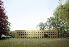 plus office architects clads sustainable library completely with golden panels in belgium