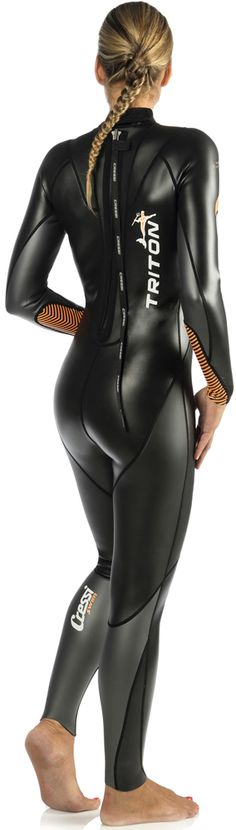 Good shape in a good shape. Woman feels breathtaking even at home in her wetsuit.