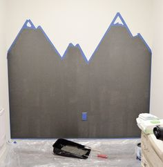 Step 2 Mountain Mural Tutorial - Easy and quick step by step DIY mountain mural tutorial for how to paint a mountain mural on a budget. Cute nursery wall idea for a mountain themed room.