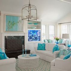 Beach cottage in white with turquoise accents. Click on picture to see the other rooms, just beautiful!