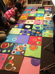 "Celebrating International Dot Day with my elementary combo class (4th/5th grade). Session 2. Using hand cut colored paper circles on 12""x12"" backgrounds. Looking at the result after a session of approximately 1 hour."