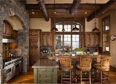 Country/Rustic (Country) Kitchen by Jerry Locati  -love he stone arch,range,rangehood, stools