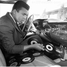 Muhammad Ali with early version of the CD player...