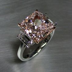 This jaw dropping carat fancy pink cushion cut diamond came to us after a famous celebrity's…un-engagement. We remade it into this beauty for another lucky client! Pink diamonds are among the rarest natural colored diamonds. Pretty Rings, Beautiful Rings, Colored Diamonds, Pink Diamonds, Cushion Cut Diamonds, Cushion Diamond, Ring Verlobung, Diamond Engagement Rings, Celebrity Engagement Rings