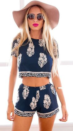Warm days usually call for something breezy and cute, and this foliage print shorts co-ord set can do the trick. It's an unlined two-piece set that comes with a pair of shorts that has an elastic waistline and a cropped top with a crew neckline and short sleeves. What makes this shorts co-ord set perfect for summer is its foliage prints and its non-stretchable cotton blend fabric. Get that edgy look by pairing this piece with a pair of ankle suede boots and a Panama hat.