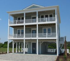 The Tyndell Plan was Built on Ocean Isle Beach with Vertical Board & Batten Siding on the front and an Eyebrow Roof. Windows are long and set at Header Custom Home Plans, Custom Home Designs, Custom Homes, Fine Home Building, Building A House, Beach Houses For Sale, Ocean Isle Beach, Beach House Plans, Cottage Plan