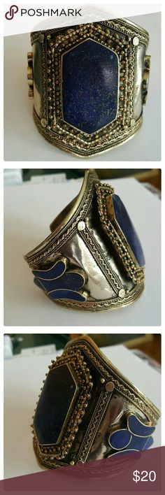 NEW LISTING: AFGHAN lapis lazuli cuff bracelet This is a hand crafted lapis lazuli cuff bracelet I bought while deployed in Afghanistan (FOB: Salerno, Khowst Province) during 2009. One of their countries few natural resources.Not sure what the metal is, maybe brass, probably a metal alloy of some sorts. I did not have a reaction while wearing it the few times that I have. I simply dont wear this one and it needs a new home where it can be shown off. Size is adjustable. It easily fits my 8 in…