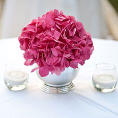Love this color pink... Pink and Pewter    This bold arrangement stands out because the flowers are in a pewter vase. Paired with white tablecloths, the whole look is sophisticated and elegant.